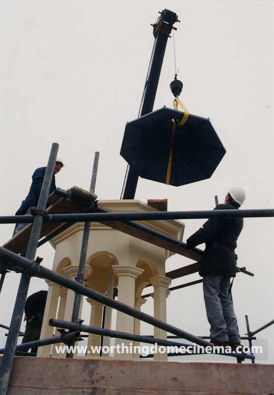 Lowering the cupola's upper part into position.