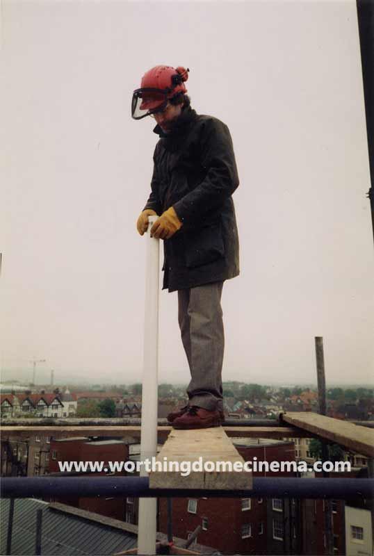Rob Blann, chairman of the Worthing Dome Preservation Trust, positioning the flagpole on top of the Dome tower.