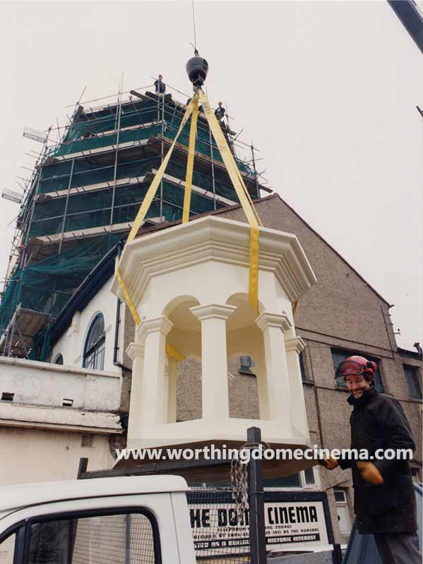 Rob Blann steadies the cupola as it is craned aloft on Sunday 30 April 1995.
