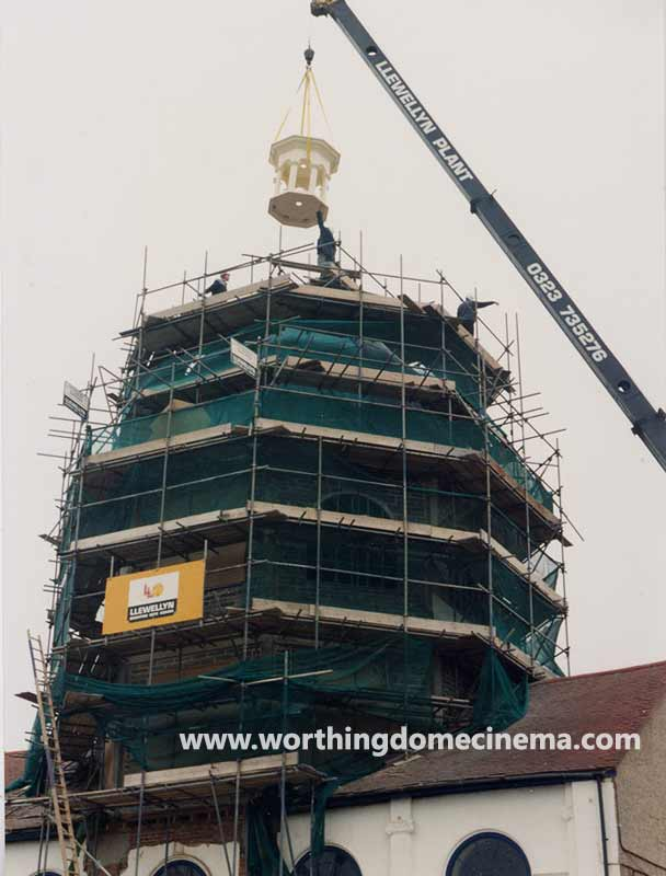 The cupola is lowered into position guided by John Head, vice chairman of the Worthing Dome Preservation Trust.